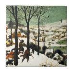 Cazadores de Pieter Bruegel en la teja de la nieve