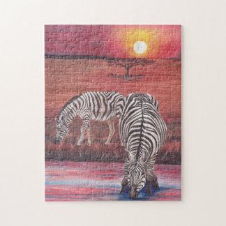 Cebras en el rompecabezas de la puesta del sol