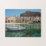 """Cefalu town in Sicily Jigsaw Puzzle<br><div class=""""desc"""">Jigsaw puzzle with two boats in the old small port of Cefalu,  an old town with crooked houses on the waterfront and a small city beach on the north coast of Sicily,  island in Italy.</div>"""