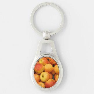 Celemín de manzanas deliciosas llavero plateado ovalado