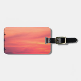 Cellular tower at sunset tags for luggage