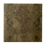 """Celtic Cross and Celtic Knots Ceramic Tile<br><div class=""""desc"""">A Celtic Cross inlaid into a stone wall with two strips of Celtic Knots overgrown in green ivy.</div>"""