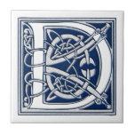 "Celtic D Monogram Ceramic Tile<br><div class=""desc"">A beautiful,  decorative embossed celtic letter illuminated with gray dragon heads on a velvety dark blue background.</div>"