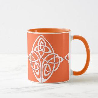 Celtic knot interwoven on orange background mug