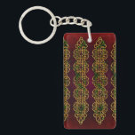 """Celtic Knot Strips Keychain<br><div class=""""desc"""">Goldl Celtic knot decoration with ivy and red background.</div>"""