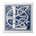 """Celtic L Monogram Tile<br><div class=""""desc"""">A beautiful,  decorative embossed celtic letter illuminated with gray dragon heads on a velvety dark blue background.</div>"""
