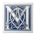 "Celtic M Monogram Ceramic Tile<br><div class=""desc"">A beautiful,  decorative embossed celtic letter illuminated with gray dragon heads on a velvety dark blue background.</div>"
