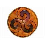 celtic triskele on gold postcard