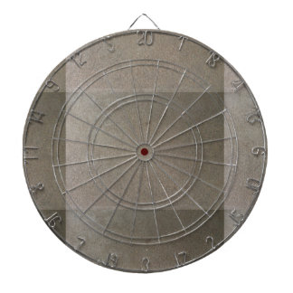 cement ( grey or gray colored concrete ) dartboard with darts