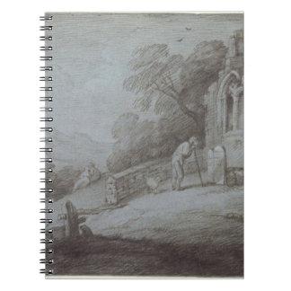 Cementerio con la figura que comtempla la piedra s libro de apuntes