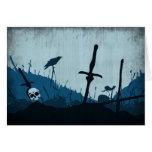 Cementerio con los cráneos y los cuervos felicitaciones