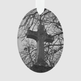 Cemetery grave cross sheltered by tree branches ornament