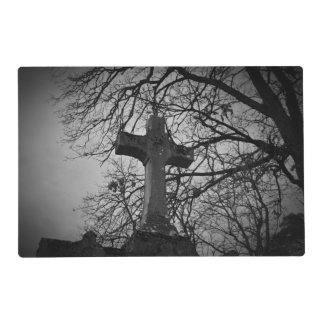 Cemetery grave cross sheltered by tree branches placemat