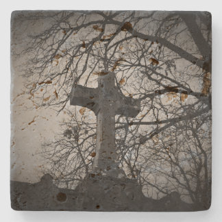 Cemetery grave cross sheltered by tree branches stone beverage coaster