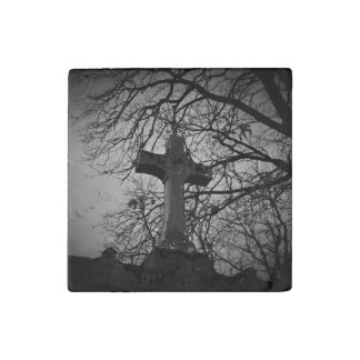 Cemetery grave cross sheltered by tree branches stone magnet