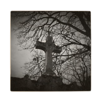 Cemetery grave cross sheltered by tree branches wooden coaster