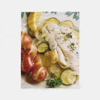 Cena cocida de los pescados