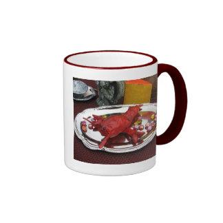 Cena de la langosta taza de café
