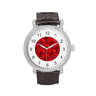 Centro abstracto del papel pintado del rosa rojo relojes de pulsera