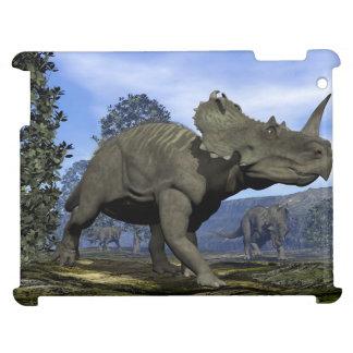 Centrosaurus dinosaurs walking among magnolia tree iPad covers
