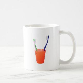 Cepillo de dientes de la papá y poco cepillo de taza de café