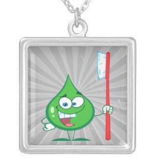 Cepillo de dientes verde de menta del carácter de colgante cuadrado