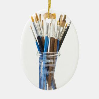 Cepillos de los artistas adorno ovalado de cerámica