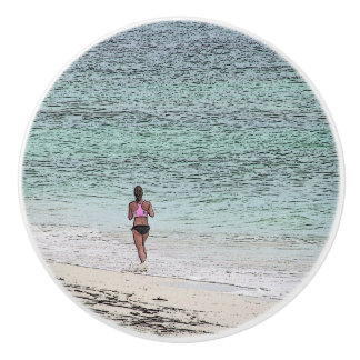 CERAMIC KNOB/ LONE FEMALE JOGGER ON CARIBBEAN BEAC CERAMIC KNOB