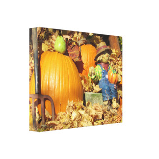 Ceramic Scarecrow and His Pumpkins Canvas Print