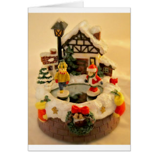 ceramic village with ice rink and skaters greeting card