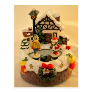 ceramic village with ice rink and skaters postcard