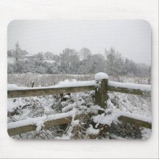 Cerca de la nieve alfombrilla de ratones