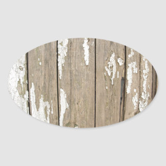 Cerca de madera vieja con la pintura exfoliated pegatina ovalada