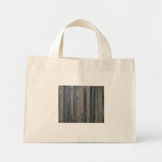 Cerca sólida de madera del listón fondo perfecto bolsas de mano