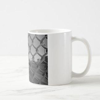 Cercado en ciudad taza de café