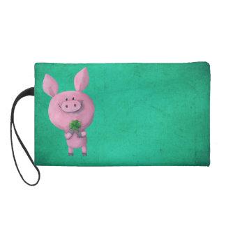 Cerdo afortunado con el trébol afortunado de cuatr