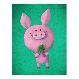 Cerdo afortunado con el trébol afortunado de postales