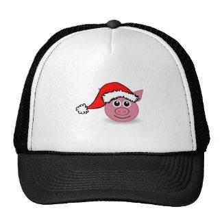 Cerdo del navidad que lleva el gorra de Santa