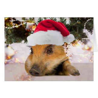 Cerdo dulce en árbol de navidad del gorra de Santa Tarjeta De Felicitación