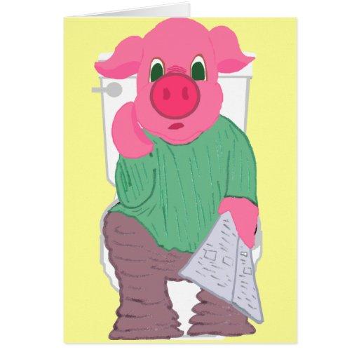 Cerdo en una tarjeta del retrete