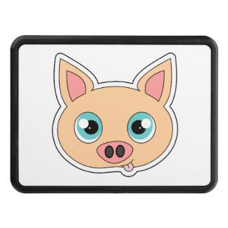 Cerdo lindo del dibujo animado con la lengua hacia tapa de remolque