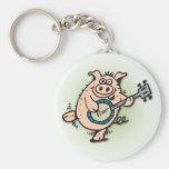Cerdo minucioso del Doodle 5 que juega llavero del