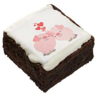 Cerdos lindos del dibujo animado en brownie del
