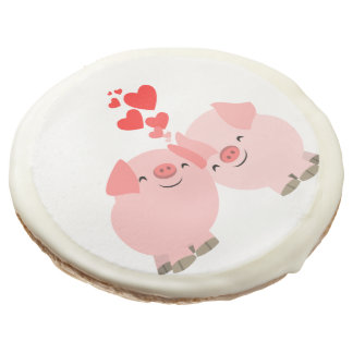 Cerdos lindos del dibujo animado en galletas del