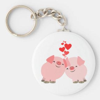 Cerdos lindos del dibujo animado en llavero del am