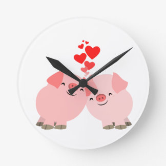 Cerdos lindos del dibujo animado en reloj de pared