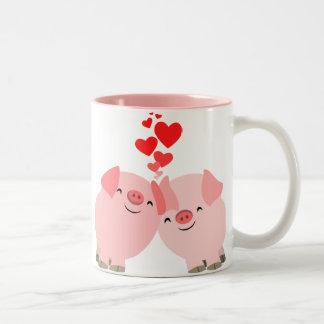 Cerdos lindos del dibujo animado en taza del amor