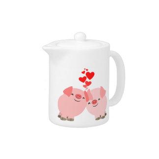 Cerdos lindos del dibujo animado en tetera del amo