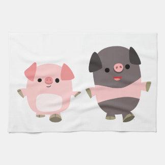 Cerdos lindos del dibujo animado en una toalla de