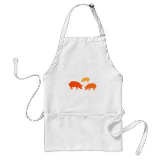 Cerdos que buscan la comida naranja delantales
